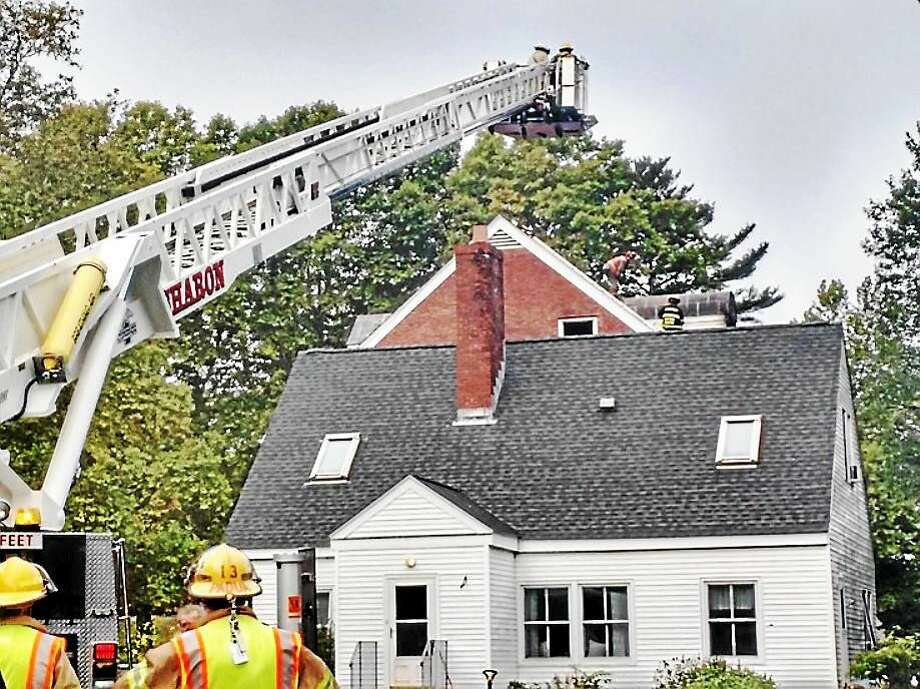 Fire crews from several Litchfield County towns responded Wednesday morning after a fire broke out in a dormitory at The Hotchkiss School in Lakeville. The blaze was contained to the dorm and its contents. Photo: Jon Barbagallo — Norfolk Volunteer Fire Department