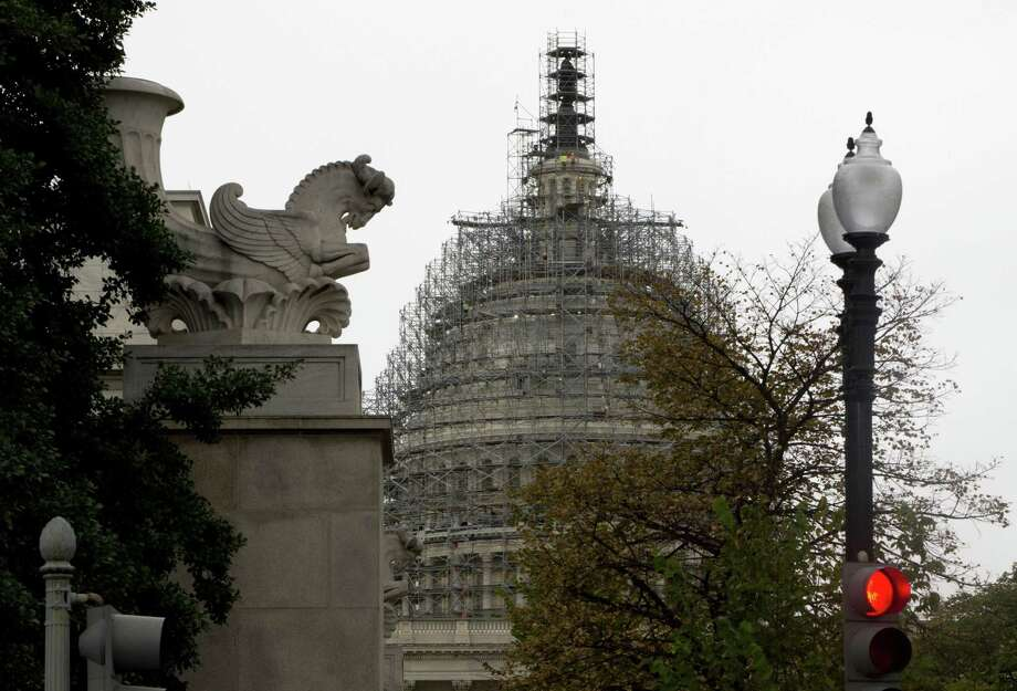 The Capitol Dome, covered with scaffolding is seen on Capitol Hill in Washington, Wednesday, Sept. 30, 2015. On Wednesday, the Senate easily approved a stopgap spending bill to avert government shutdown; House to follow. Photo: AP Photo/Carolyn Kaster   / AP