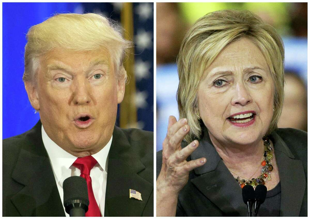 File-This file photo combo of file images shows U.S. presidential candidates Donald Trump, left, and Hillary Clinton. Trump wants to spur more job creation by reducing regulations and cutting taxes to encourage businesses to expand and hire more.He also says badly negotiated free trade agreements have cost millions of manufacturing jobs. He promises to bring those jobs back by renegotiating the NAFTA agreement with Canada and Mexico, withdrawing from a proposed Pacific trade pact with 11 other nations, and pushing China to let its currency float freely on international markets.Clinton has promised to spend $275 billion upgrading roads, tunnels and modern infrastructure such as broadband Internet, to create more construction and engineering jobs. Trump has said in interviews he would spend twice as much. (AP Photo/Mary Altaffer, Chuck Burton, File)
