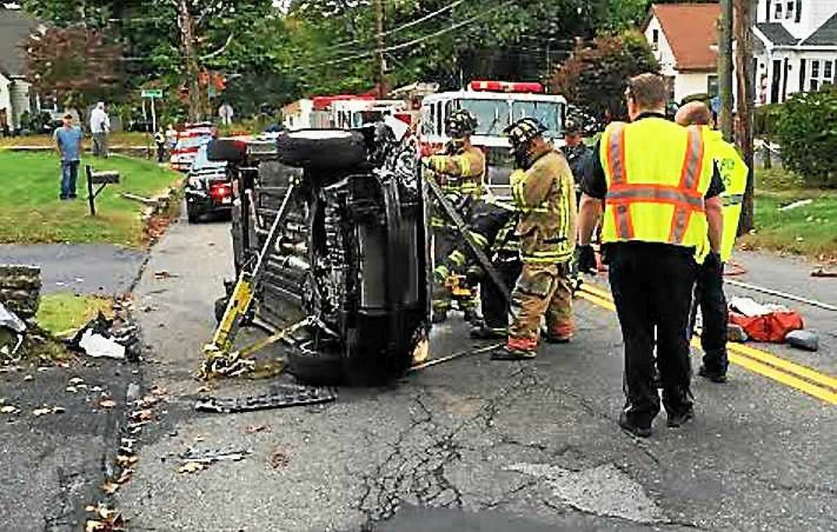 A woman was rescued after her car flipped over on Charles Street in Torrington early Wednesday afternoon. She suffered minor injuries and the road was closed for a short time.