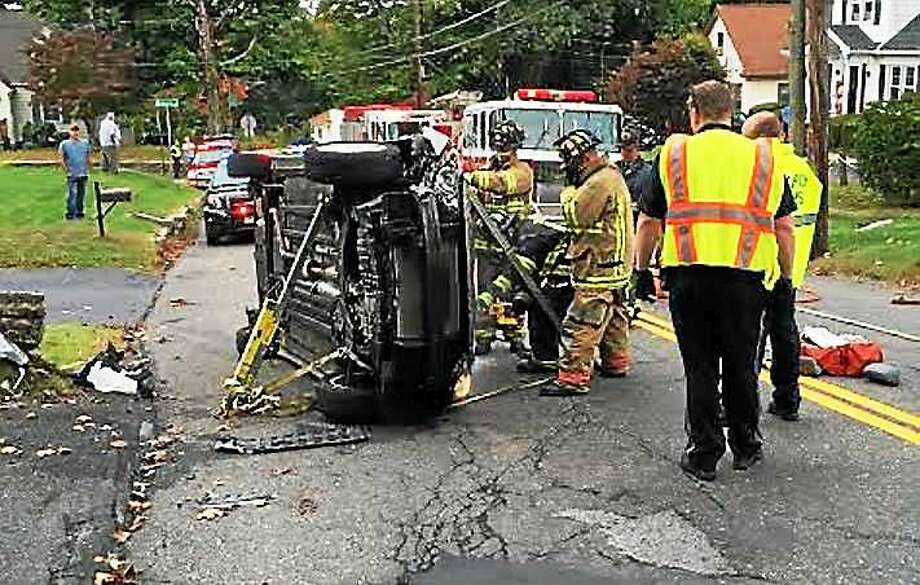 A woman was rescued after her car flipped over on Charles Street in Torrington early Wednesday afternoon. She suffered minor injuries and the road was closed for a short time. Photo: (Contributed Photo)