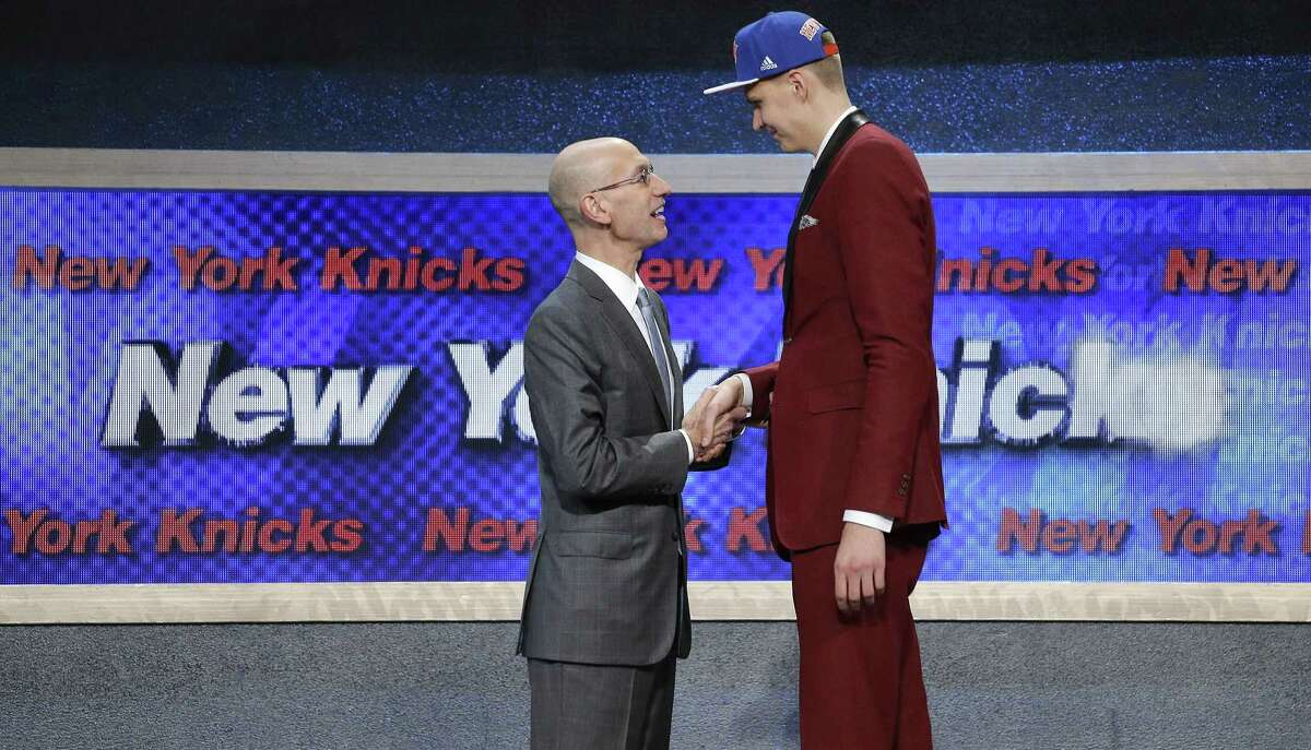 Kristaps Porzingis, right, is greeted by NBA Commissioner Adam Silver after being selected fourth overall by the New York Knicks during the NBA basketball draft, Thursday, June 25, 2015, in New York. (AP Photo/Julie Jacobson)