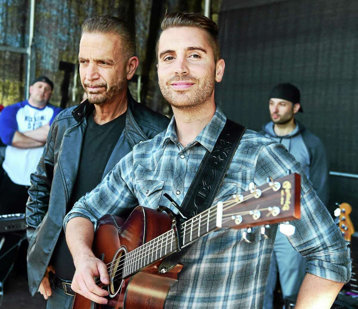 American Idol's Nick Fradiani of Guilford, right, with his father Nick Fradiani III before they perform a concert on the Guilford Green after a welcome home parade May 1 in Guilford.