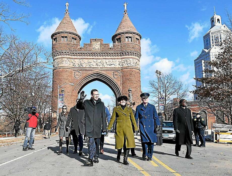 Governor Dannel P. Malloy waves as he walks up Trinity St. with his wife, Catherine, during the Inaugural Parade in Hartford on January 7, 2015. Photo: (Arnold Gold — New Haven Register)