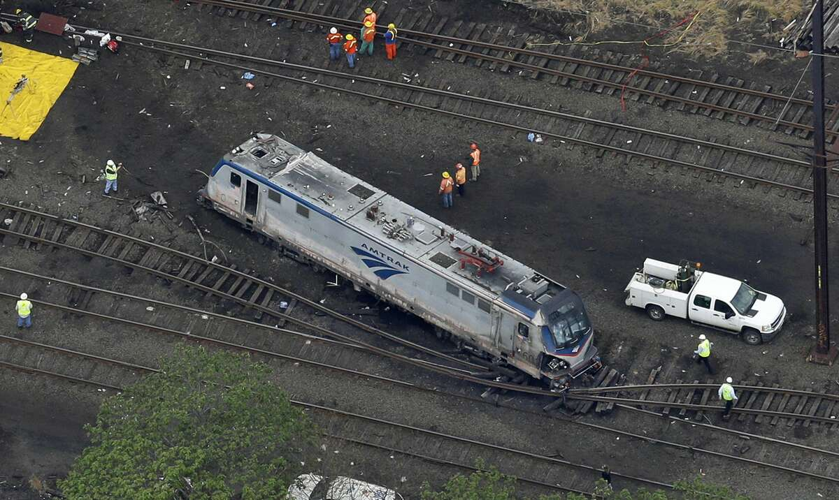 In this aerial photo, emergency personnel work at the scene of a deadly train wreck Wednesday in Philadelphia.