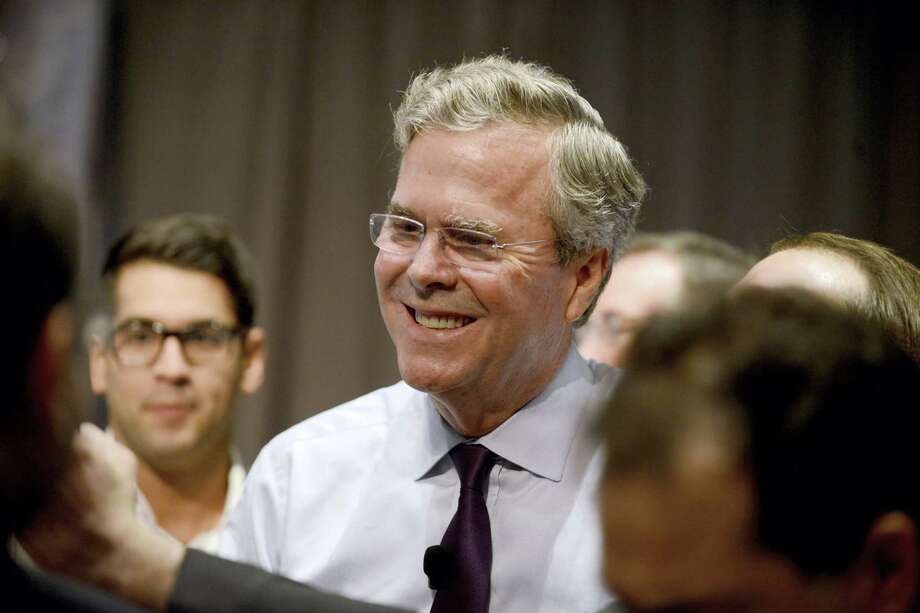 Republican presidential candidate Jeb Bush talks with an attendee at the Forum Club of the Palm Beaches on Dec. 28, 2015 in West Palm Beach, Fla. Photo: Maria Lorenzino/South Florida Sun-Sentinel Via AP  / South Florida Sun-Sentinel