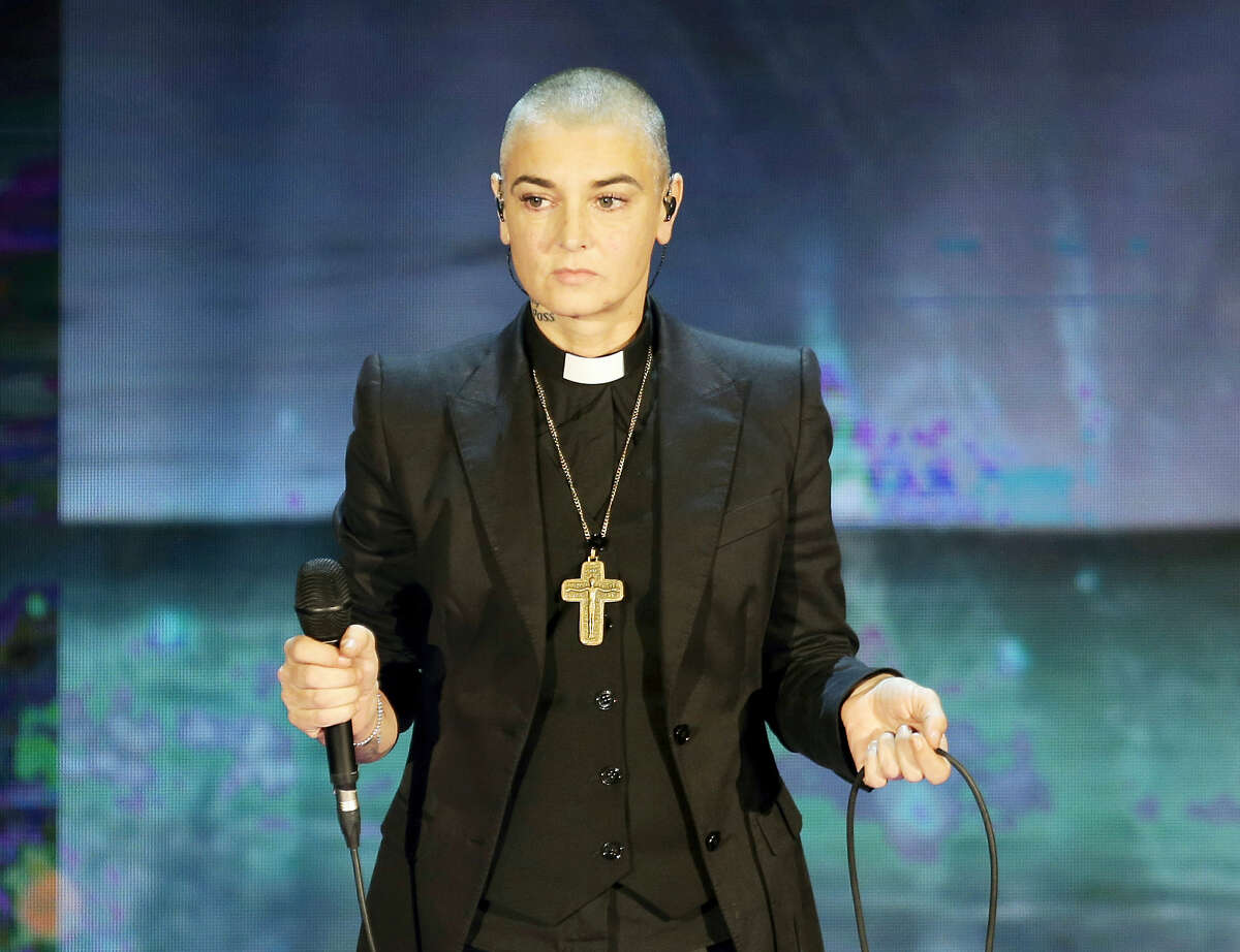 """In this Oct. 5, 2014 photo, Irish singer Sinead O'Connor performs during the Italian State RAI TV program """"Che Tempo che Fa"""", in Milan, Italy. Police in suburban Chicago have put out a well-being check for the Irish singer."""