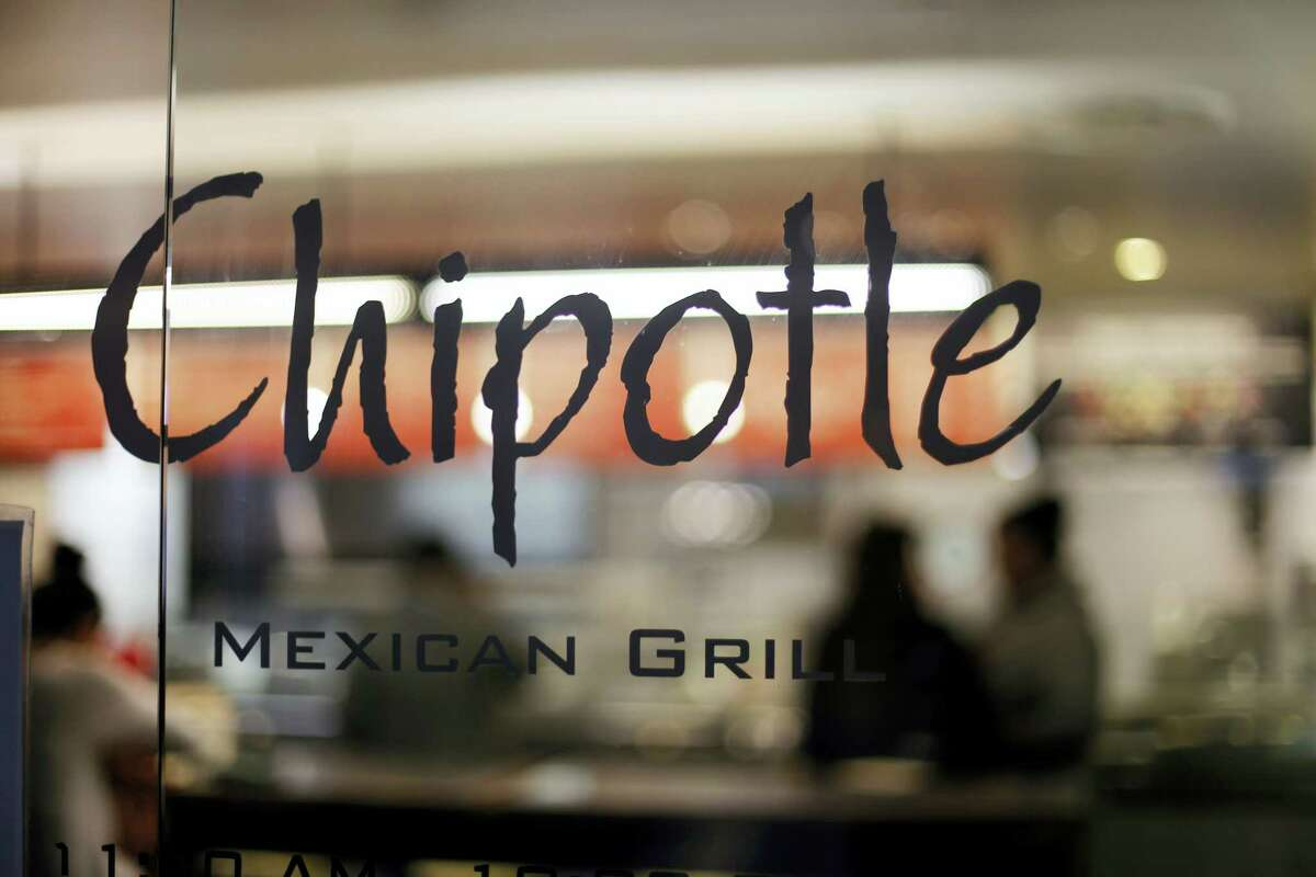 This Dec. 27, 2015 photo shows a Chipotle restaurant at Union Station in Washington. Chipotle said on Wednesday, Jan. 6, 2016 that it has been served with a federal grand jury subpoena as part of a criminal investigation tied to a norovirus outbreak last summer at one of its restaurants in California.