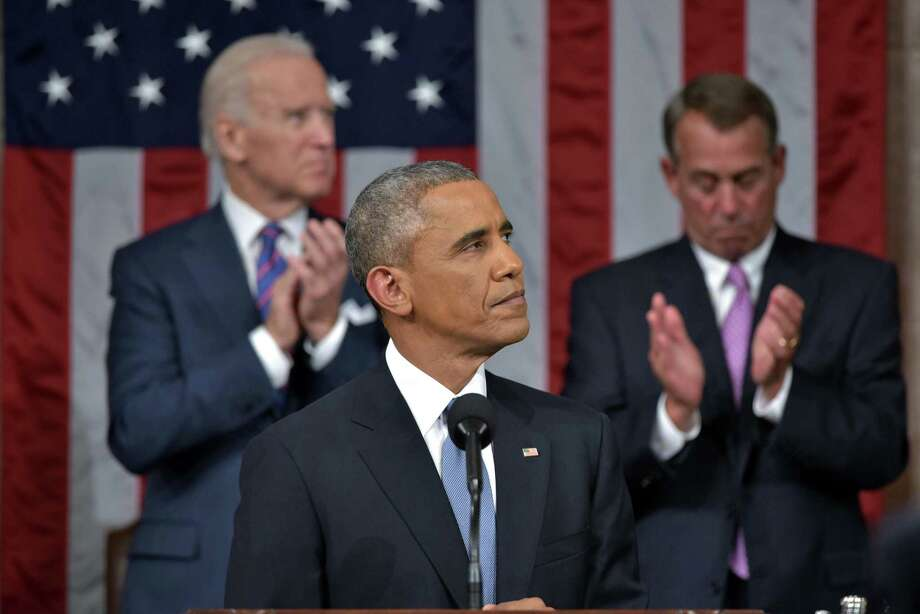 President Barack Obama arrives to deliver his State of the Union address to a joint session of Congress on Capitol Hill on Tuesday, Jan. 20, 2015, in Washington. Applauding are Vice President Joe Biden and House Speaker John Boehner of Ohio. Photo: (Mandel Ngan — The Associated Press) / Pool AFP