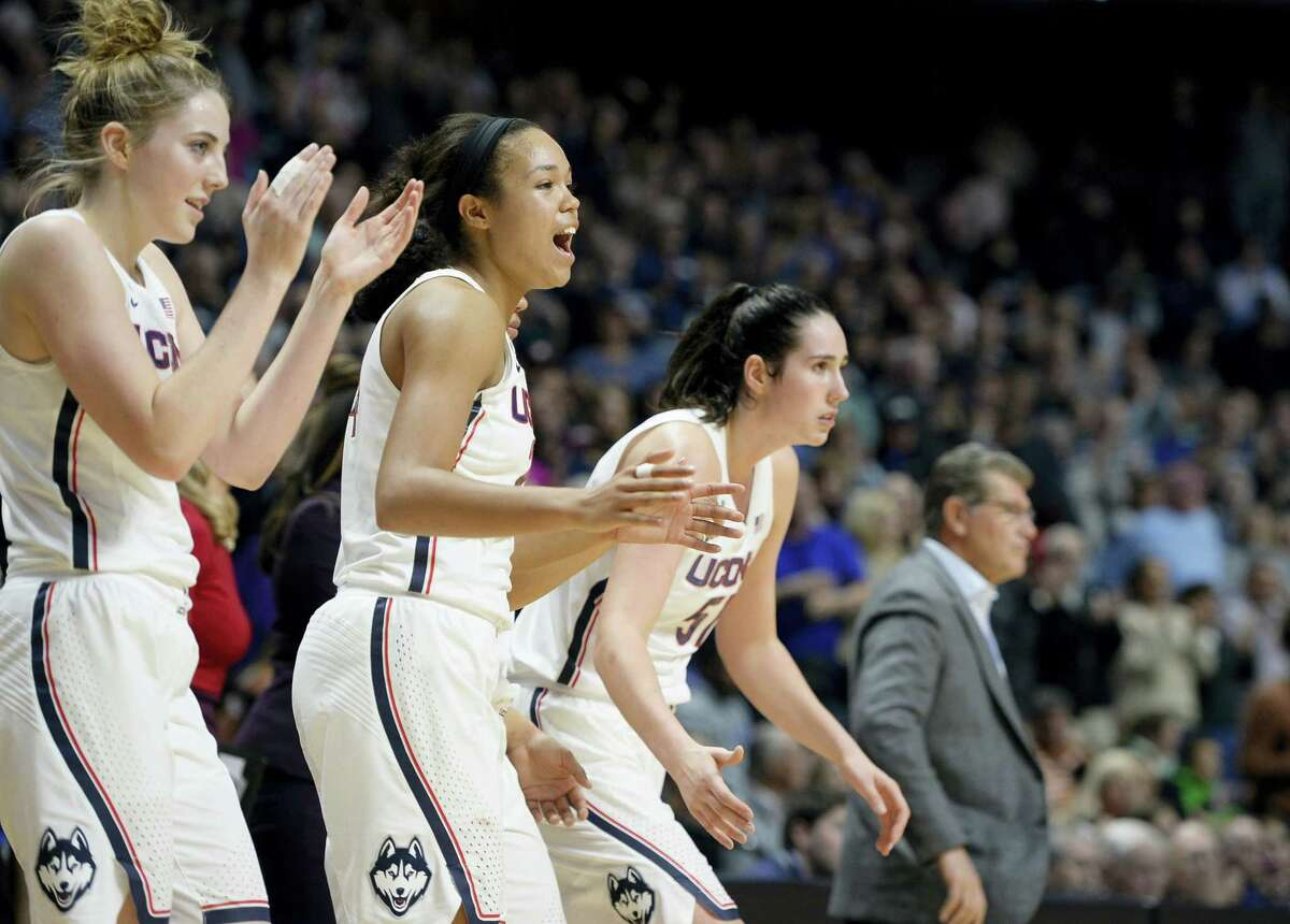 From the left, Connecticut's Katie Lou Samuelson, Connecticut's Napheesa Collier, and Connecticut's Natalie Butler in the second half of an NCAA college basketball game, Sunday, Dec. 4, 2016, in Uncasville.