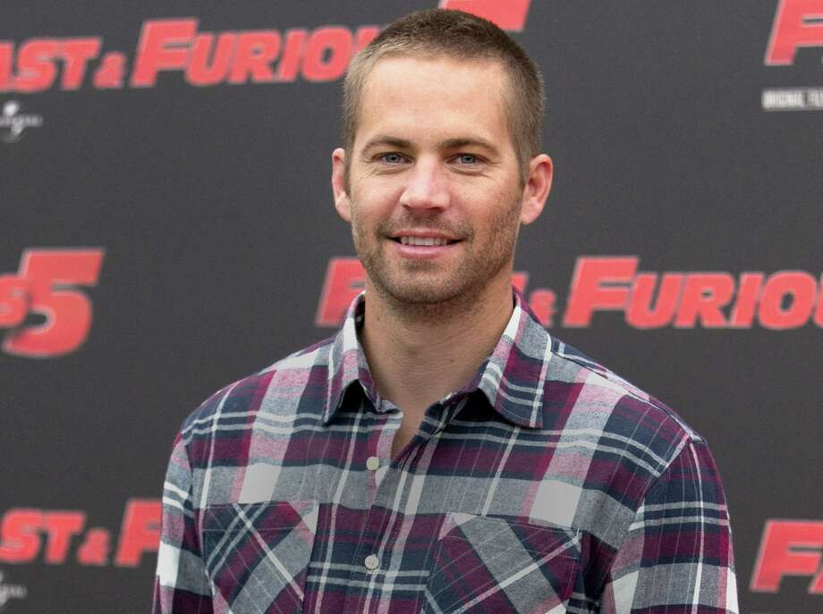 """In this April 29, 2011, file photo, actor Paul Walker poses during the photo call of the movie """"Fast and Furious 5,"""" in Rome. Paul Walkerís daughter, Meadow Rain Walker, has filed a lawsuit Monday, Sept. 28, 2015, against Porsche, claiming the sports car that her father was a passenger in when he was killed in late 2013 suffered from numerous design defects. Photo: AP Photo/Andrew Medichini, File   / AP"""
