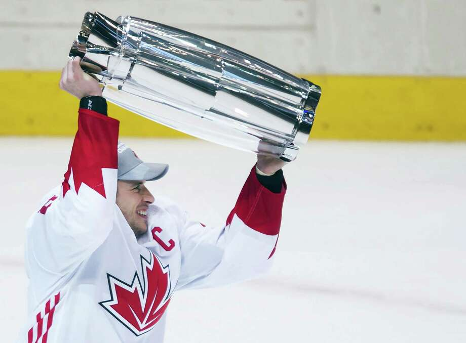 Canada captain Sidney Crosby hoists the trophy after Canada defeated Europe in the World Cup of Hockey finals in Toronto on Thursday. Photo: Nathan Denette — The Canadian Press Via AP  / The Canadian Press