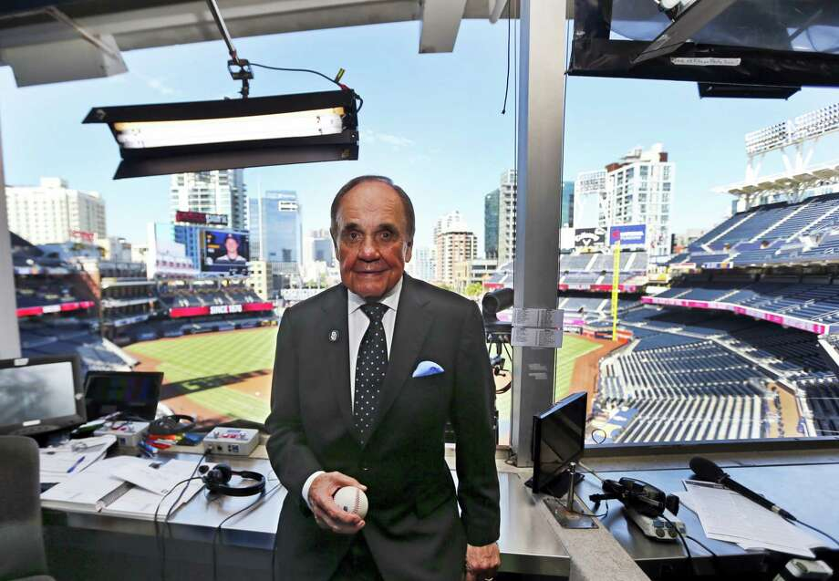 Dick Enberg, the voice of the San Diego Padres, poses in his booth prior to the Padres' final home baseball game in San Diego. Photo: Lenny Ignelzi — The Associated Press  / Copyright 2016 The Associated Press. All rights reserved.