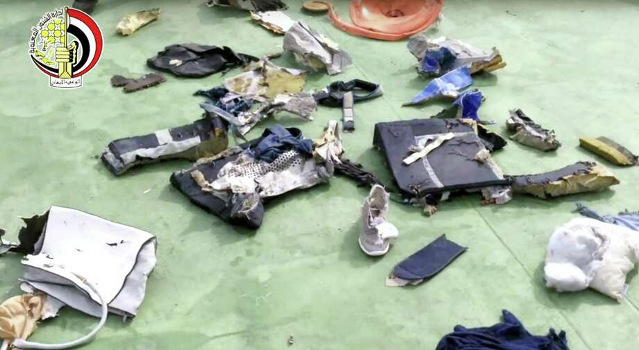 This still image taken from video posted May 21, 2016 on the official Facebook page of the Egyptian Armed Forces spokesman shows some personal belongings and other wreckage from EgyptAir flight 804 in Egypt. Photo: Egyptian Armed Forces Via AP, File  / Egyptian Armed Forces