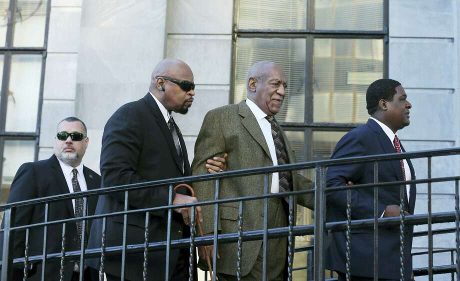Actor and comedian Bill Cosby, second right, arrives for a court appearance Tuesday, Feb. 2, 2016, in Norristown, Pa. Cosby was arrested and charged with drugging and sexually assaulting a woman at his home in January 2004. Photo: AP Photo/Mel Evans   / AP