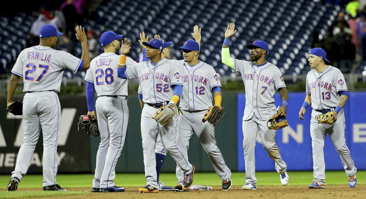Members of the Mets celebrate after Friday's win over the Phillies on Friday.