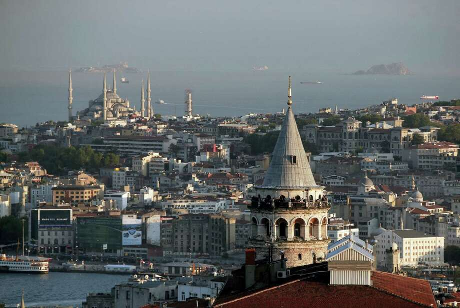 This Friday, May 6, 2016, file photo shows a view of Istanbul's skyline with the iconic Galata Tower and the Ottoman-era Sultan Ahmed Mosque, background left, better known as the Blue Mosque. The number of foreigners arriving in Turkey in May was 2.48 million, down 34.6 percent from the same month in 2015, according to government data. Photo: AP Photo/Lefteris Pitarakis, File   / Copyright 2016 The Associated Press. All rights reserved. This material may not be published, broadcast, rewritten or redistribu