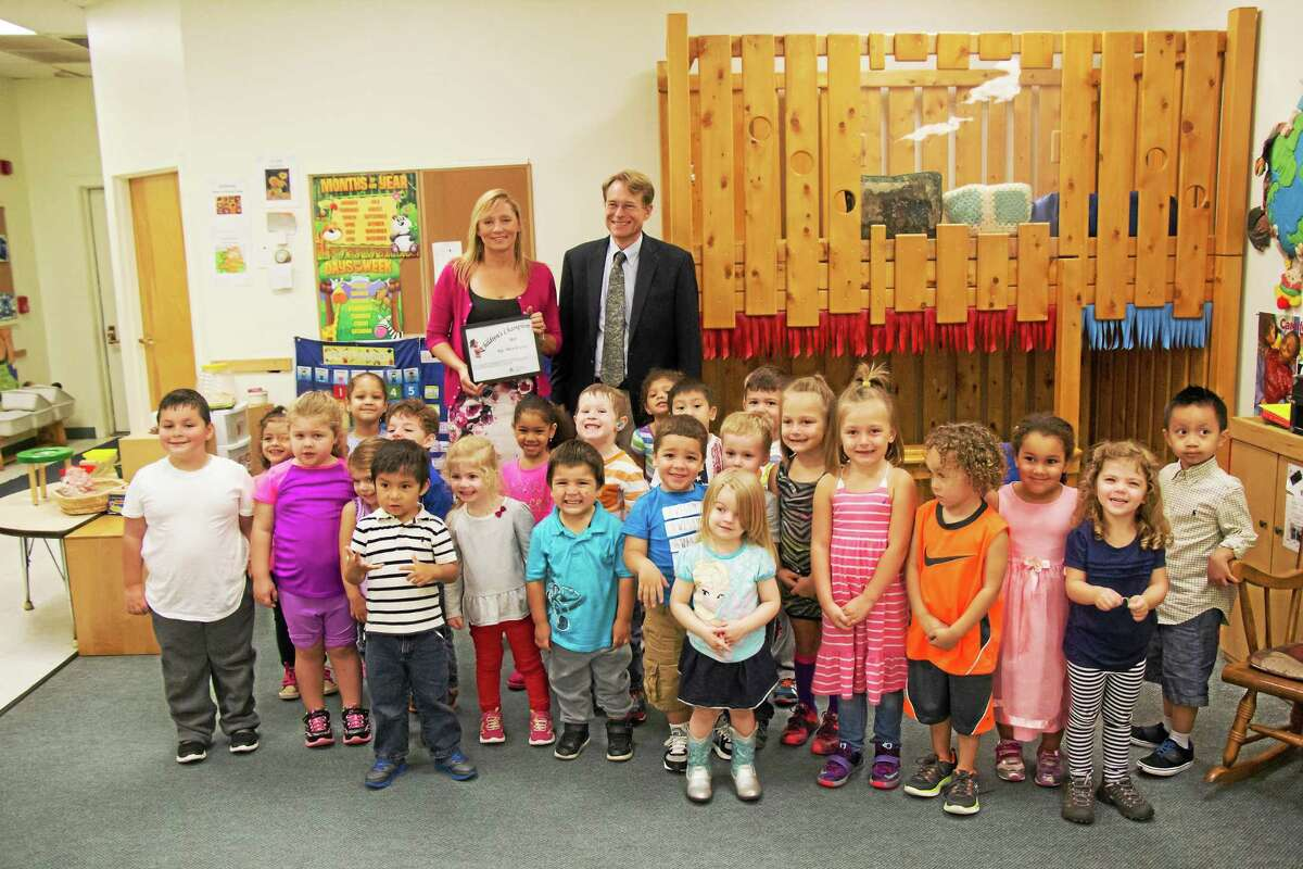 CONTRIBUTED PHOTO State Rep. Michelle Cook was recognized with a ceremony at the Torrington Child Care Center Tuesday.