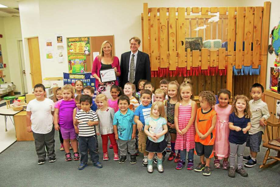 CONTRIBUTED PHOTO State Rep. Michelle Cook was recognized with a ceremony at the Torrington Child Care Center Tuesday. Photo: Journal Register Co.