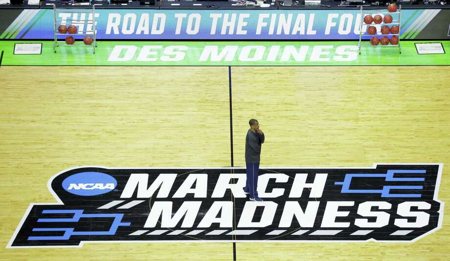 Connecticut head coach Kevin Ollie watches his team during practice for a first-round men's college basketball game in the NCAA Tournament, Wednesday, March 16, 2016, in Des Moines, Iowa. Connecticut will play Colorado on Thursday. (AP Photo/Charlie Neibergall) Photo: AP / Copyright 2016 The Associated Press. All rights reserved. This material may not be published, broadcast, rewritten or redistributed without permission.