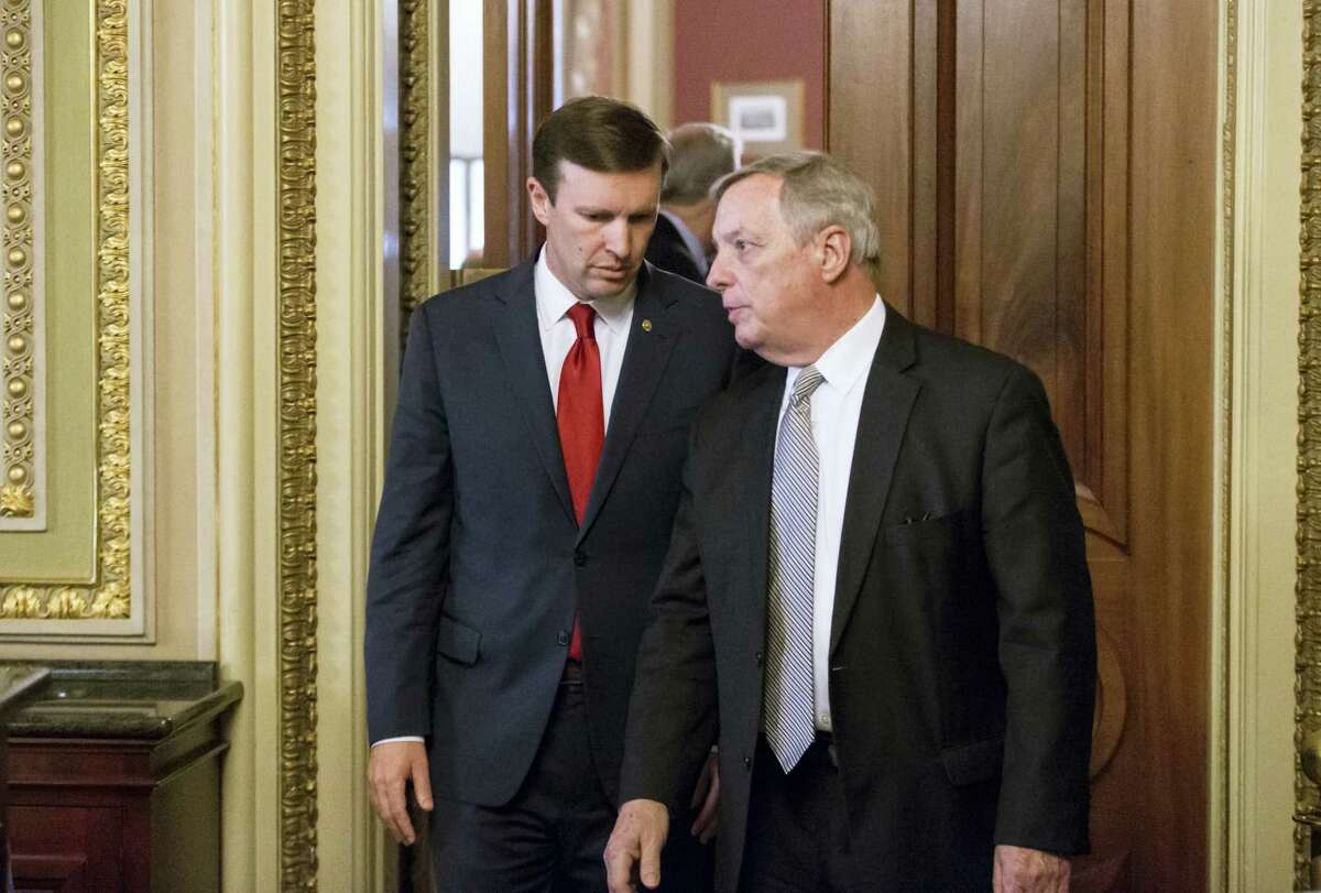 In this photo taken June 14, 2016, U.S. Sen. Chris Murphy, D-Conn., left, confers with Senate Minority Whip Richard Durbin, D-Ill., emerge from a closed-door party caucus on Capitol Hill in Washington. Murphy is launching a filibuster and demanding a vote on gun control measures. The move comes three days after people were killed in a mass shooting in Orlando.