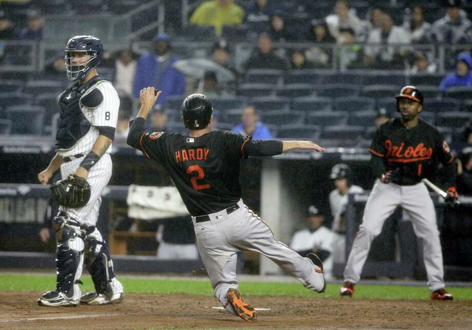 The Orioles' J.J. Hardy (2) scores on a double by second baseman Jonathan Schoop in the fourth inning on Friday. Photo: Julie Jacobson — The Associated Press  / Copyright 2016 The Associated Press. All rights reserved.