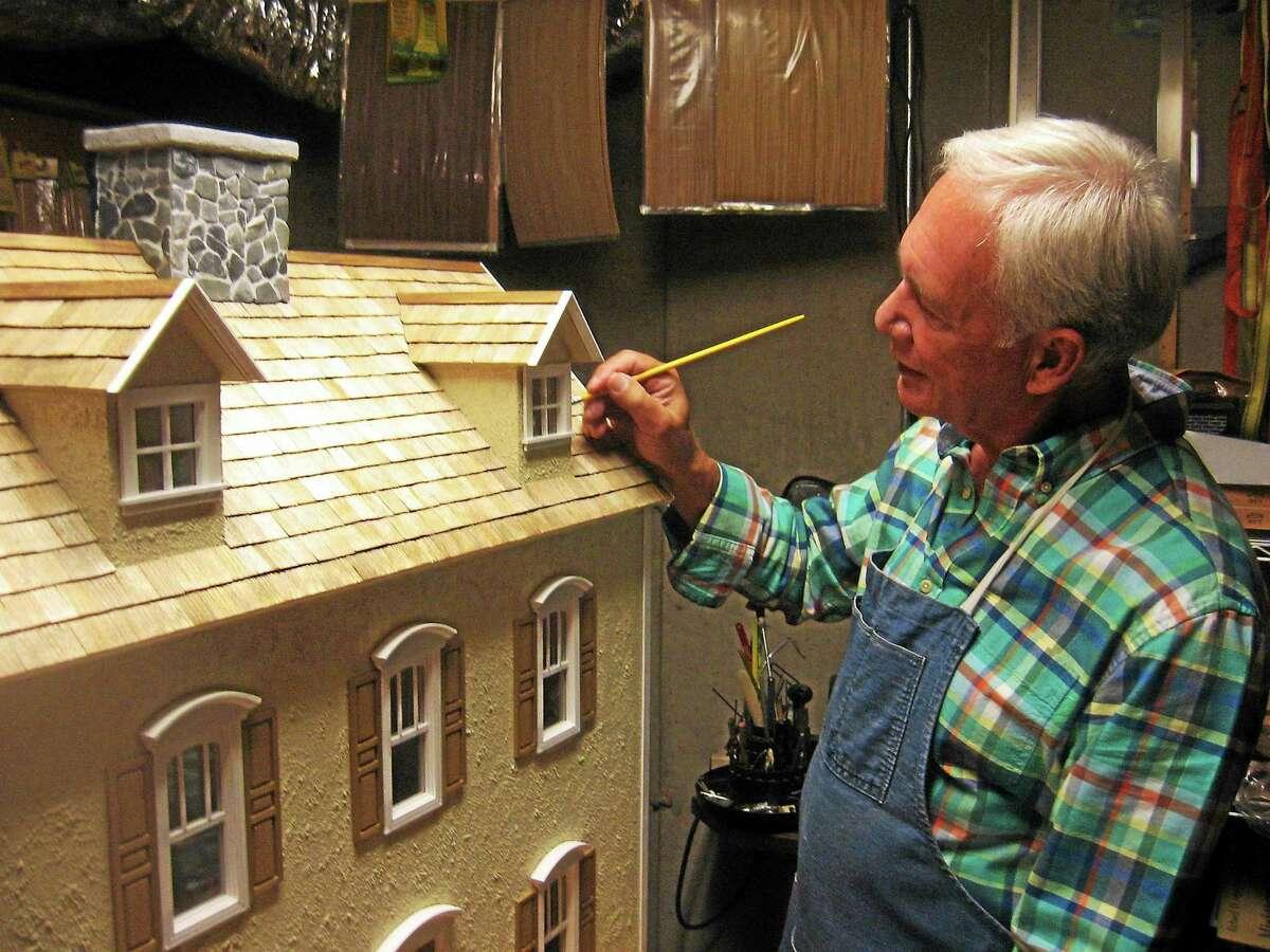 Master dollhouse builder Rick Maccione plying his craft.
