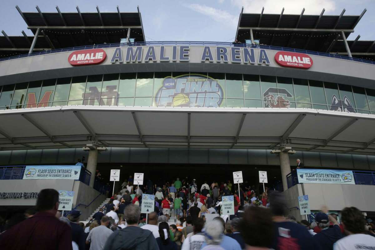 Fans walk into the stadium before the start of the national championship game between UConn and Notre Dame on Tuesday in Tampa, Fla.