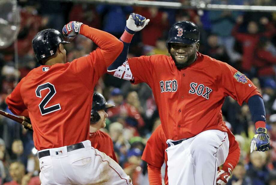 David Ortiz, right, celebrates his two-run home run with Xander Bogaerts (2) during the seventh inning on Friday. Photo: Elise Amendola — The Associated Press  / AP
