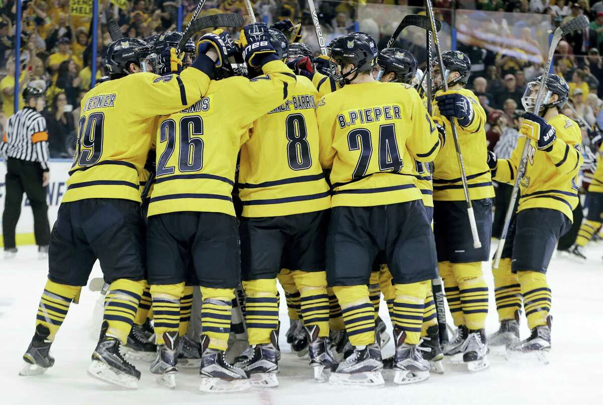 Quinnipiac players celebrate their 3-2 win over Boston College during an NCAA Frozen Four semifinal college hockey game Thursday, April 7, 2016, in Tampa, Fla. (AP Photo/Chris O'Meara)