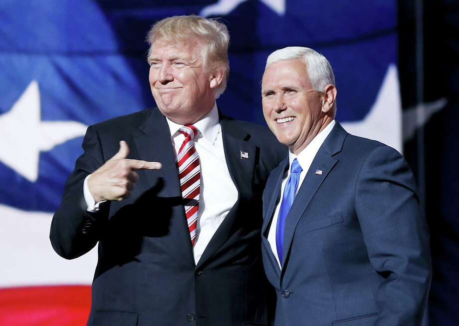 Republican presidential candidate Donald Trump, points toward Republican vice presidential candidate Indiana Gov. Mike Pence after Pence's acceptance speech during the third day session of the Republican National Convention in Cleveland, Wednesday, July 20, 2016. (AP Photo/Mary Altaffer) Photo: AP / Copyright 2016 The Associated Press. All rights reserved. This material may not be published, broadcast, rewritten or redistribu