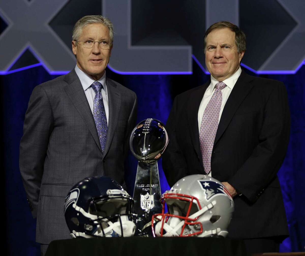 Seattle Seahawks coach Pete Carroll, left, and New England Patriots coach Bill Belichick will face each other on Sunday in Super Bowl XLIX in Phoenix.