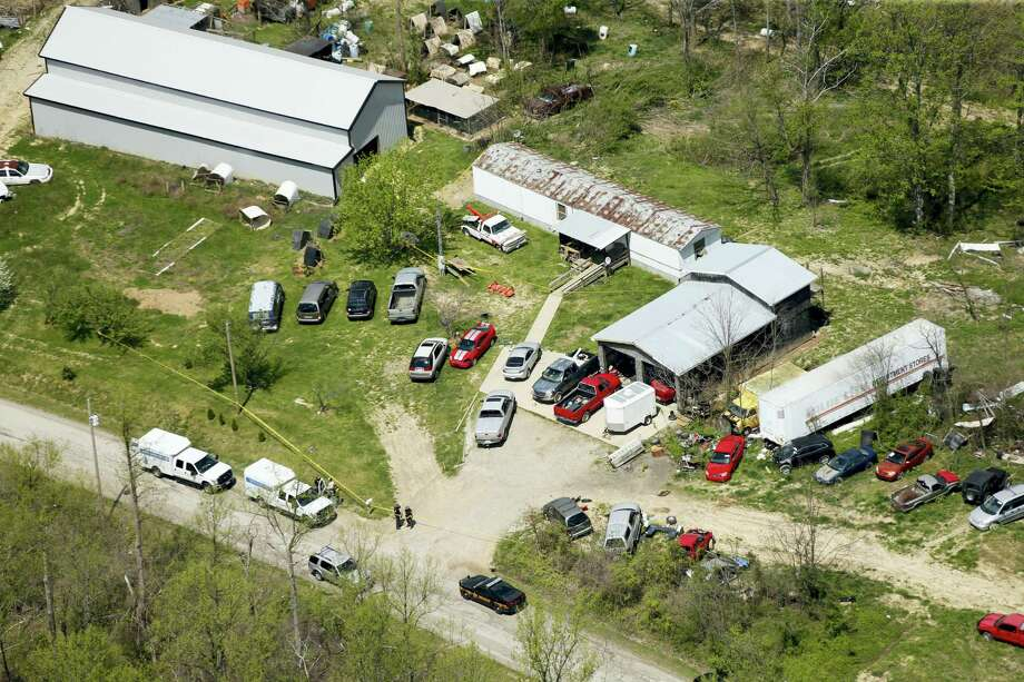 This aerial photo shows one of the locations being investigated in Pike County, Ohio, as part of an ongoing homicide investigation on April 22, 2016.  Several people were found dead Friday at multiple crime scenes in rural Ohio, and at least most of them were shot to death, authorities said. No arrests had been announced, and it's unclear if the killer or killers are among the dead. Photo: Lisa Marie Miller/The Columbus Dispatch Via AP  / The Columbus Dispatch