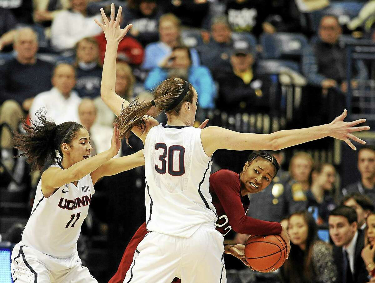 Temple's Tanaya Atkinson, right, looks to pass around UConn's Kia Nurse, left, and Breanna Stewart during a Jan. 14 game in Storrs.