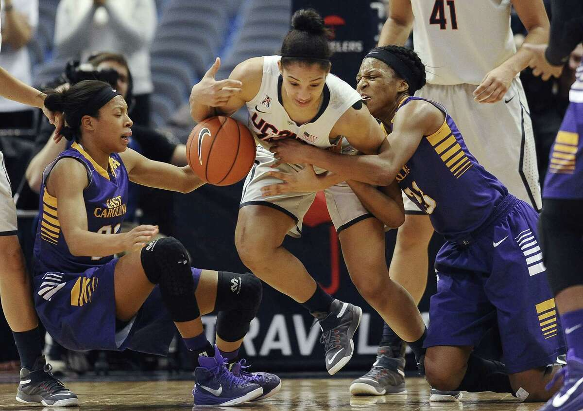 East Carolina's Abria Trice, left, and Jada Payne surround UConn's Gabby Williams during Wednesday's game in Hartford.