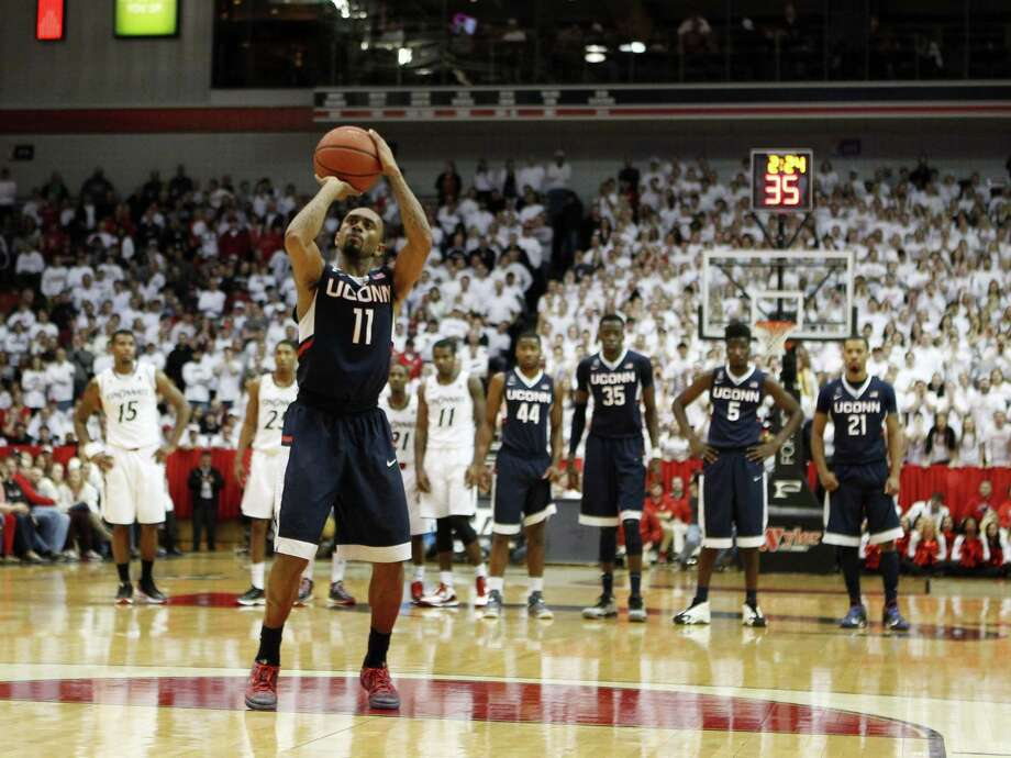 UConn's Ryan Boatright shoots a technical free throw during Thursday's loss at Cincinnati. Photo: Frank Victores — The Associated Press  / FR170726 AP