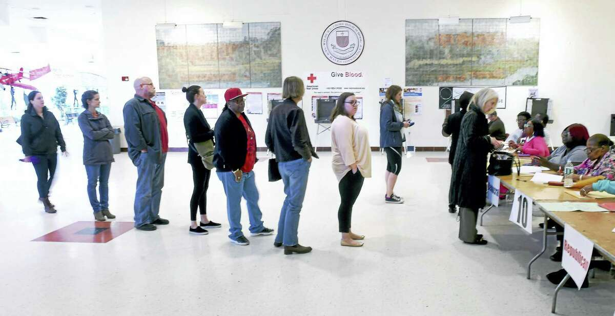 People stand in line to vote at Wilbur Cross High School in New Haven Tuesday, April 26, 2016.