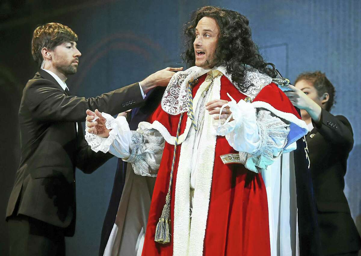 """Greg Keller as Charles II and George W. Bush and members of the ensemble, Hudson Oznowicz and Evelyn Giovine, in dress rehearsal at the Yale Repertory Theatre world premiere of """"Scenes from Court Life, or the whipping boy and his prince,"""" on Wednesday at University Theatre at 222 York St. in New Haven. The production runs through Oct. 22."""