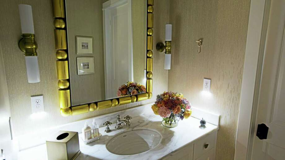 Two SnapPower Guidelights are displayed in this bathroom, but one is enough to get the job done. Photo: Contributed