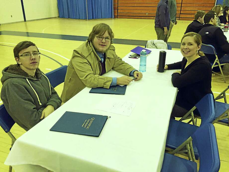 Contributed photo Wamogo Regional High School students, from left, are Chandler Beeman and Johnathon Clement, with teacher Brooke Matuszczak at Quinnipiac University on Jan. 14. Photo: Journal Register Co.