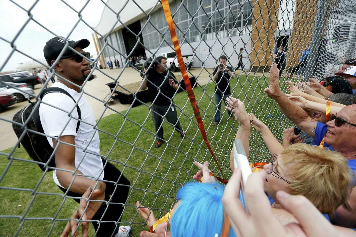 Oklahoma City's Kevin Durant (35) greets fans after the Oklahoma City Thunder arrive home from the NBA Western Conference Finals at Will Rogers Airport in Oklahoma City, Tuesday. The Thunder lost to the Golden State Warriors in Game 7 of the series Monday night.