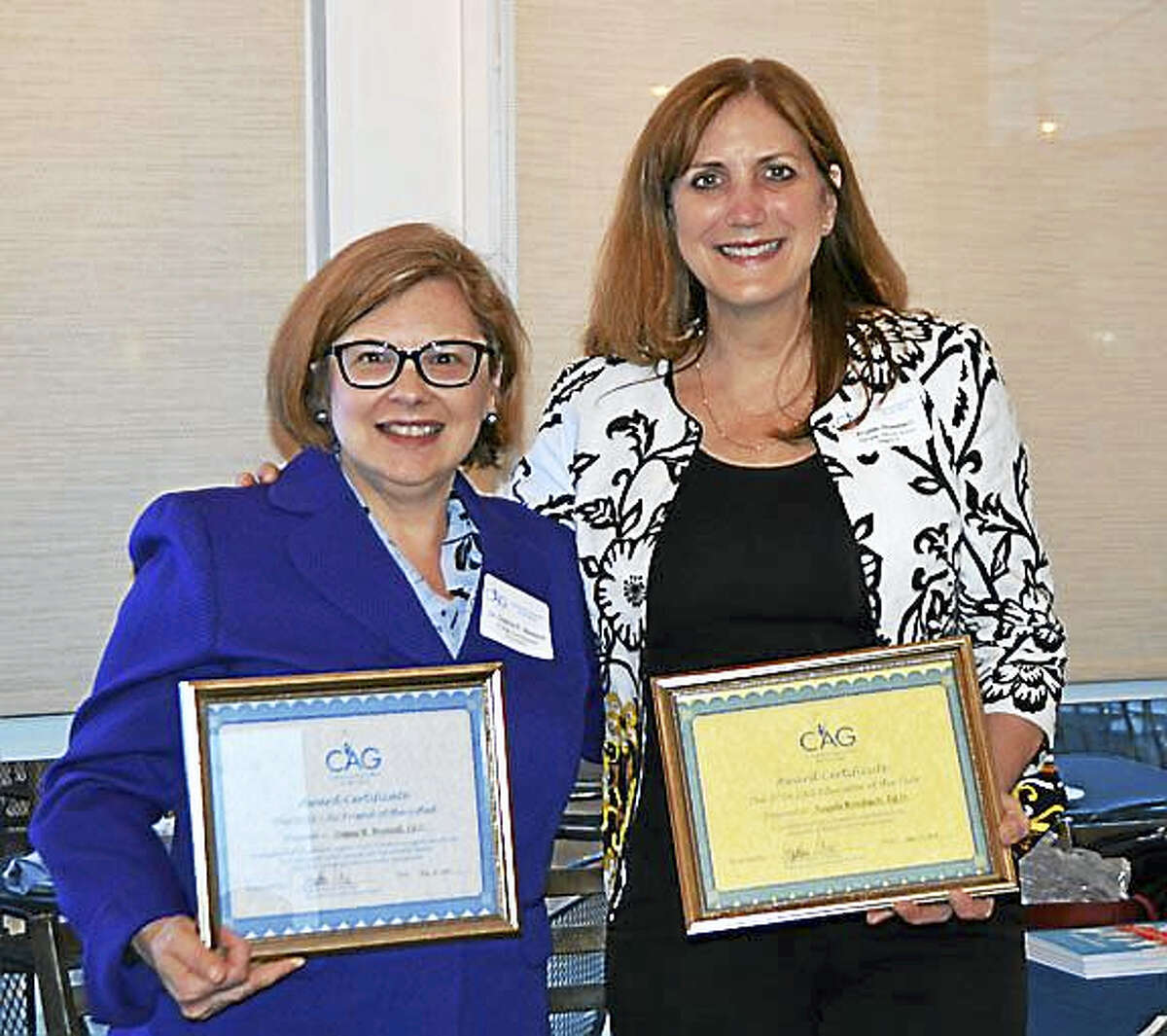 Photo 4 – L to R - Commissioner of the Connecticut State Department of Education Dr. Dianna R. Wentzell holds the Connecticut Association for the Gifted (CAG) 2016 Friend of the Gifted Award, and Dr. Angela Rossbach, Principal of Warren (CT) Elementary School poses with an award given to her by the Connecticut Association for the Gifted (CAG), the 2016 'Educator of the Year'. The awards were given at a ceremony May 10 in Milford, CT. Photo Courtesy of the Connecticut Association for the Gifted.