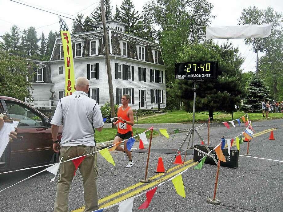 Winner Scott Shaw crosses the finish line. Photo: Photo By John Torsiello