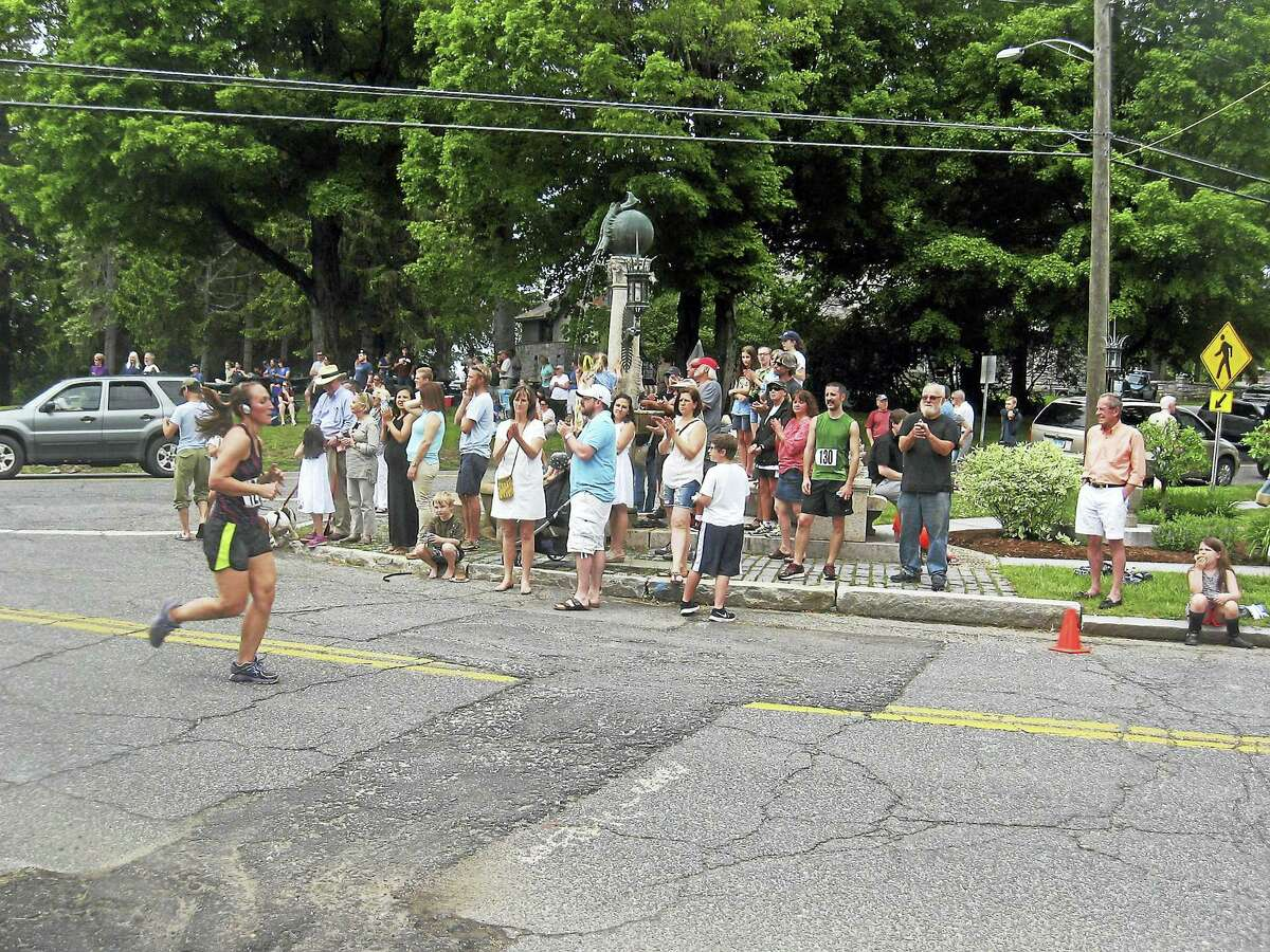 Fans cheer on the runners.