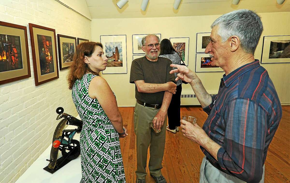 """From left are Melissa (Roth) Cherniske, photographer Emery ìTedî Roth II and George Ogno, of New Milford, who has been a fan of Rothís work and finally had the chance to meet him at Washington Art Association's opening of """"Re: Fabrications"""" on Sept. 12. Melissa, Emery's daughter, is also a photographer."""