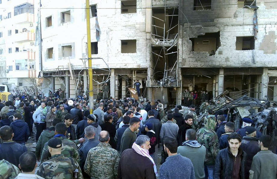 In this photo released by the Syrian official news agency SANA, Syrians gather where three bombs exploded in Sayyda Zeinab, a predominantly Shiite Muslim suburb of the Syrian capital, Syria, Sunday, Jan. 31, 2016. The triple bombing claimed by the extremist Islamic State group killed at least 45 people near the Syrian capital of Damascus on Sunday, overshadowing an already shaky start to what are meant to be indirect Syria peace talks. Photo: SANA Via AP  / SANA