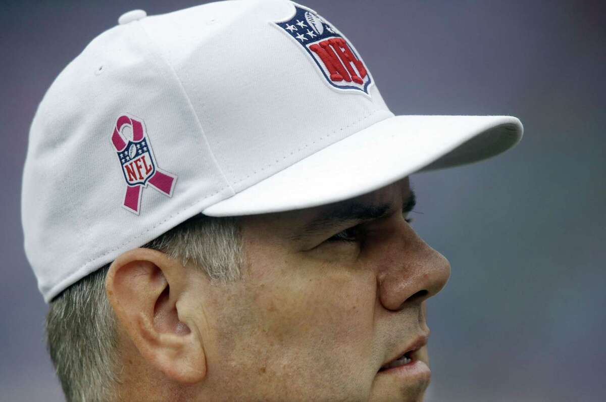 In this Oct. 6, 2013 file photo, referee Bill Vinovich wears a breast cancer awareness logo on his cap before a game between the Tennessee Titans and the Kansas City Chiefs in Nashville.