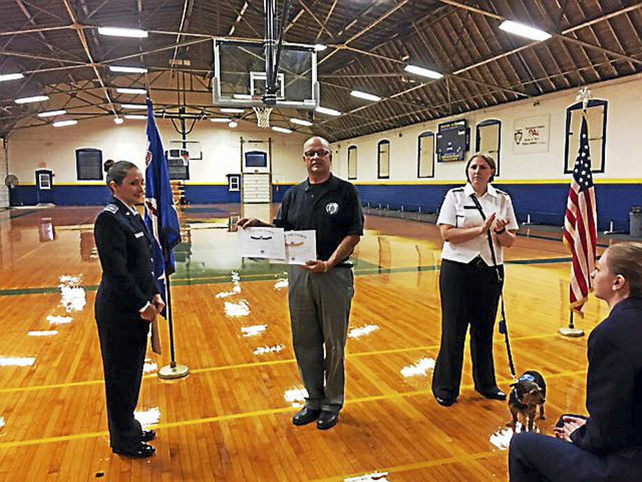 CONTRIBUTED PHOTO  From left are Civil Air Patrol officers Lt. Lt. Col. Megan Brownell, Maj. Timothy Ceritello and Maj. Jessica Dey. Photo: Journal Register Co.