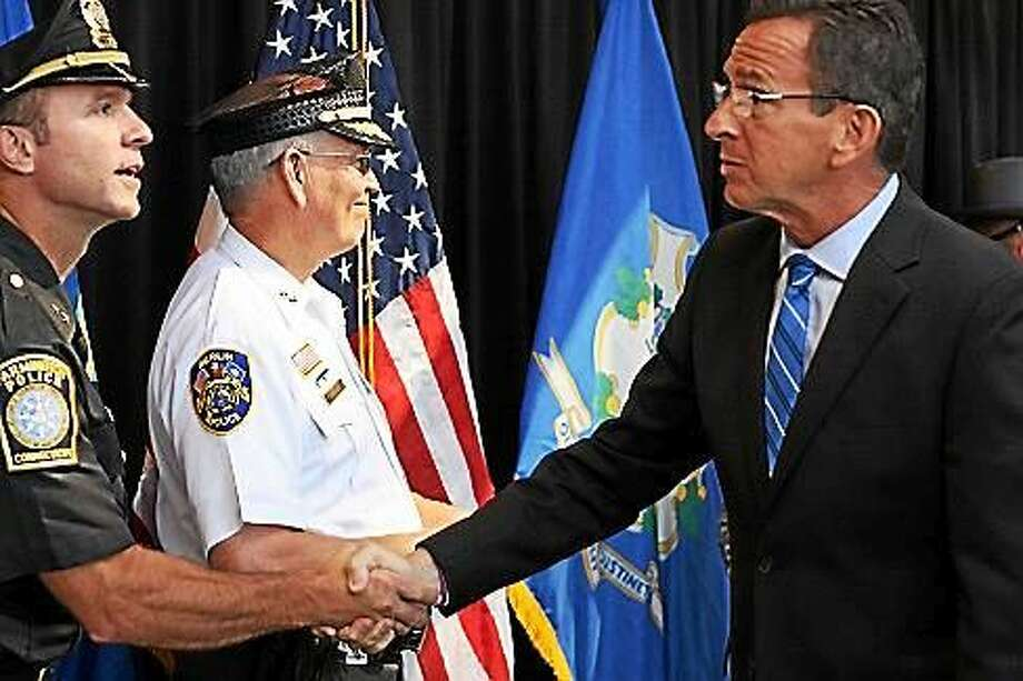 Gov. Dannel P. Malloy greets Farmington Police Department Chief Paul J. Melanson Photo: PHOTO BY ELIZABETH REGAN