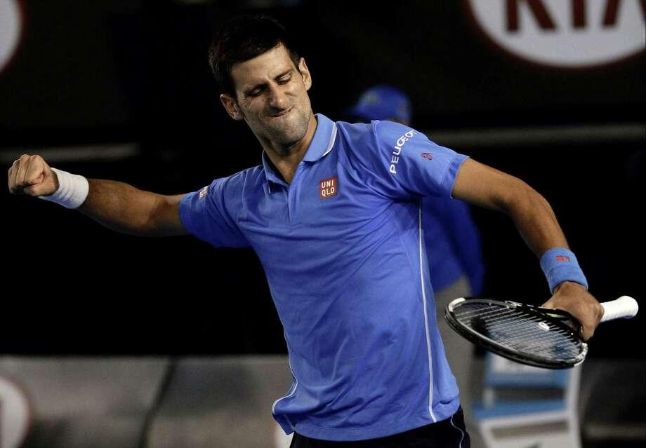 Novak Djokovic celebrates match point after defeating Stan Wawrinka in their semifinal match at the Australian Open in Melbourne on Friday. Photo: Bernat Armangue — The Associated Press  / AP